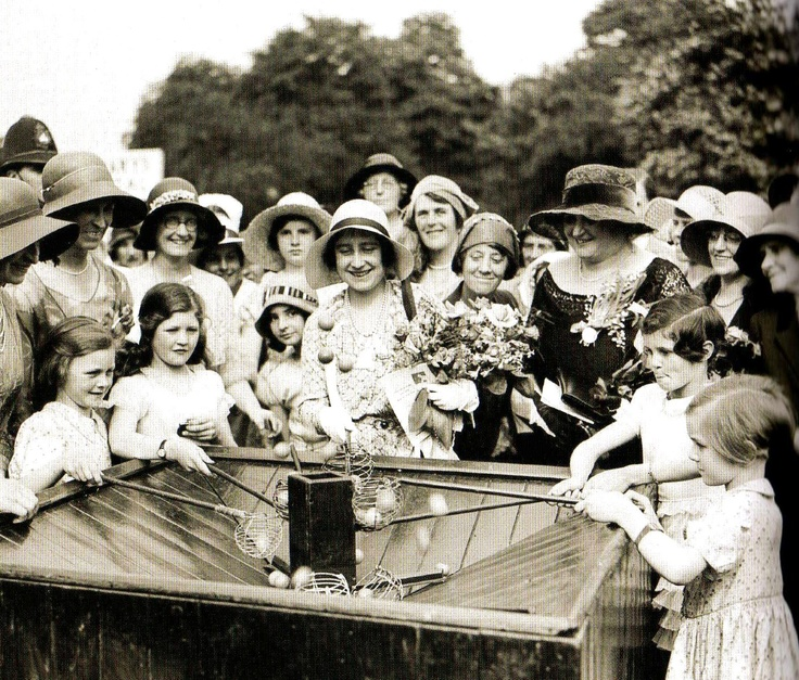 The Duchess of York playing a game with children at the opening ceremony of a Boys and Girls Club at Dagenham, Essex - UK - 6 July 1933