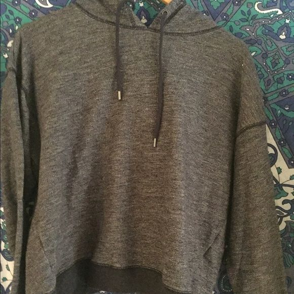 GapFit Grey Sweatshirt w Back Detail Be comfortable and fashionable in this cozy chic hoodie by GapFit!! The back has a cute crossover scalloped detail that meets in a v and allows for a light breeze up the back as well as a cute detail. GAP Tops Sweatshirts & Hoodies