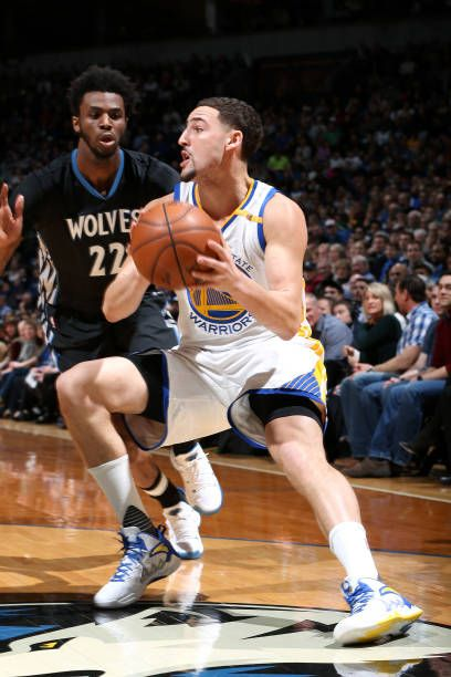 Klay Thompson of the Golden State Warriors handles the ball during the game against the Minnesota Timberwolves on March 10 2017 at Target Center in...