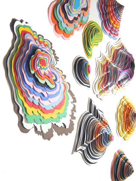 Paper sculpture    Use large sheets of paper and then a generic cardboard shape in between each sheet to add dimension. Could be easily assembled with glue does.     Possible topographic map model?