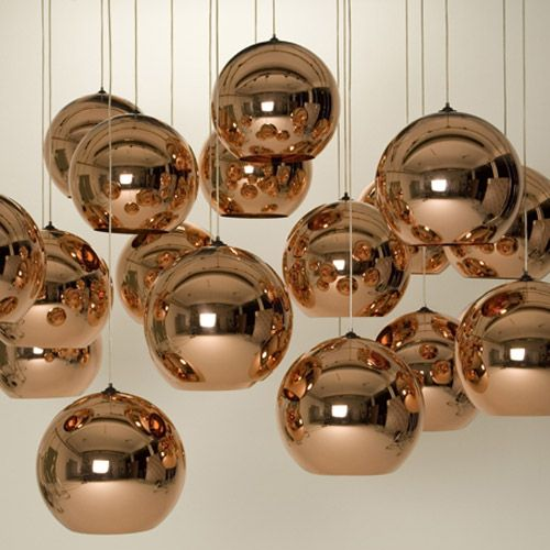 These lights reflect light and are made out of copper. The material makes the lamp look industrial