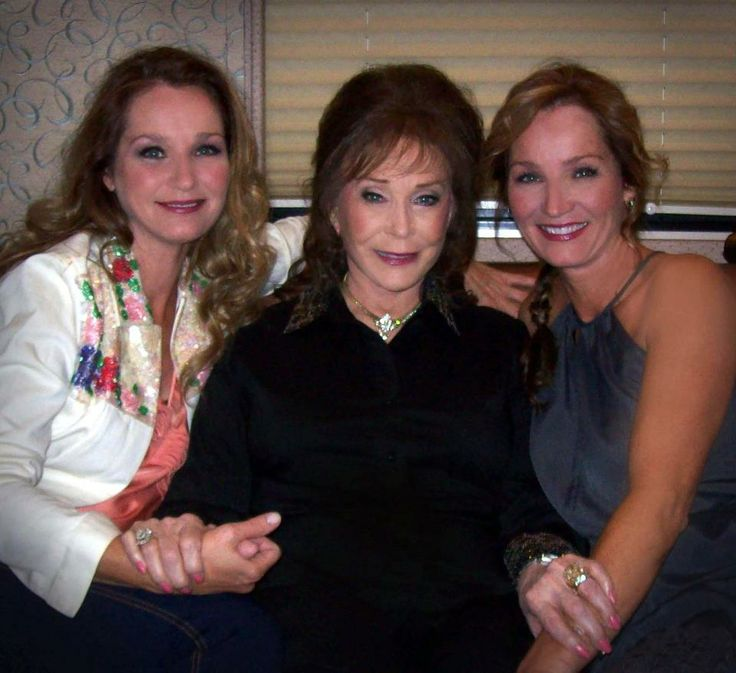 Loretta Lynn and her twins, Peggy and Patsy, at an appearance in Clinton, OK (2012). The twins are 48 yrs. old. [Courtesy of Tim Cobb]