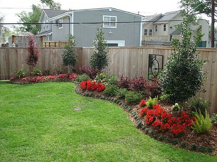Backyard landscaping along fence