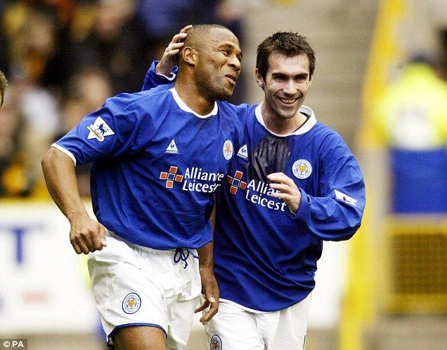Les Ferdinand celebrates withKeith Gillespie (right) after scoring against Wolves in 2003