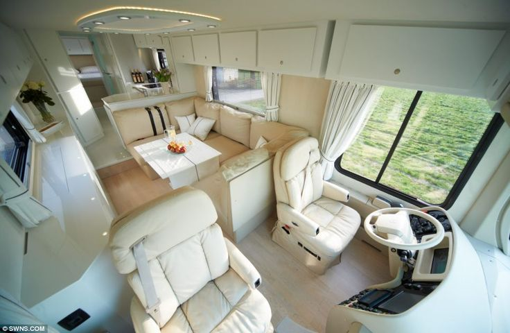 Comfort: The driver has plenty of rooms to stretch his legs as he sits behind the wheel, while the bedroom area (pictured behind the front seats) converts into a TV lounge