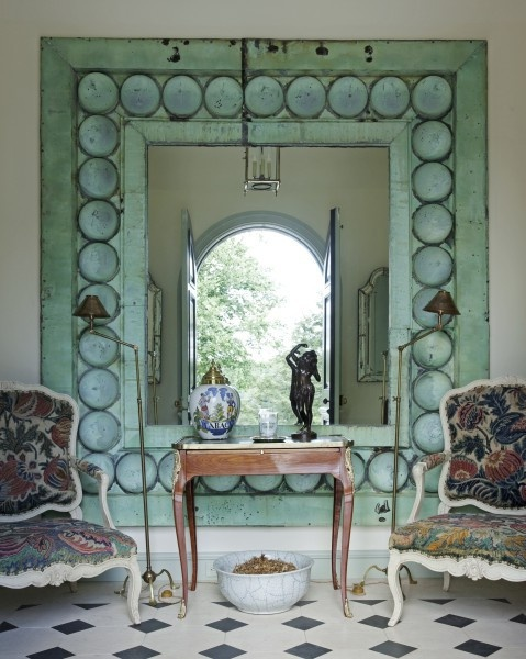Beautifully colored frame, unusual mirror