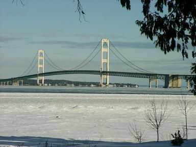 Mackinac Bridge connecting upper and lower Michigan. It is approximately 5 miles long from shore to shore. We traveled over the bridge last summer. It crosses the straits between Lake Michigan and Lake Huron.