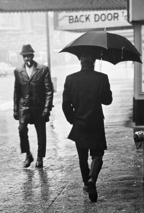 Urban City Street Scene, Falling Rain, Pedestrians With & Without Umbrellas…