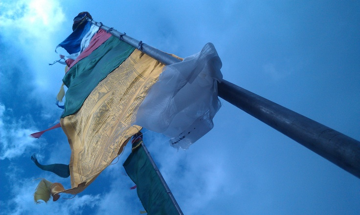 A prayer flag on the mast, this type is mostly used in homes/houses (domestic).