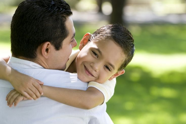 hispanic dads and their kids | Father and Son Embrace