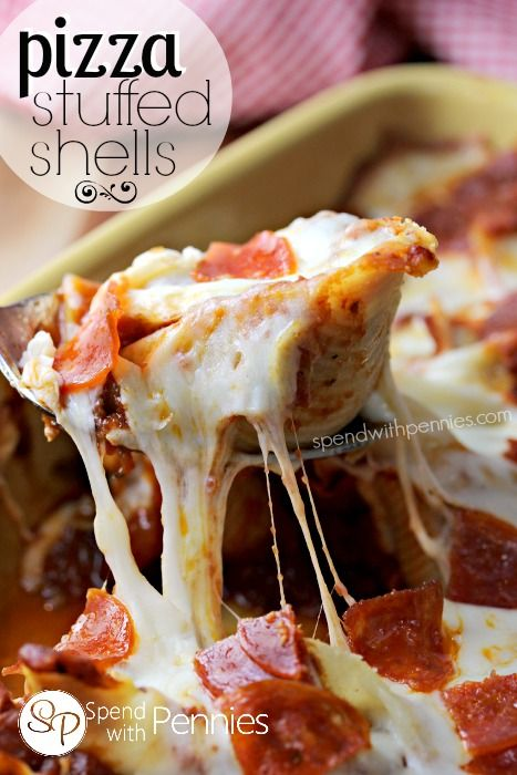 Pizza Stuffed Shells!  Delicious pasta shells stuffed with a lean beef & pepperoni filling and topped with gooey mozzarella cheese!