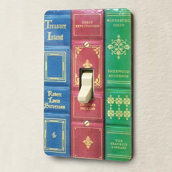 cut spines off 2-3 books of chosen colors or titles, glue to switch plate, use longer screws