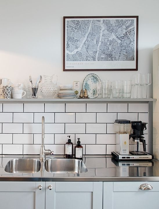 I don't like the generic tiles but I like the shelves on top of tiles and stainless steel sink