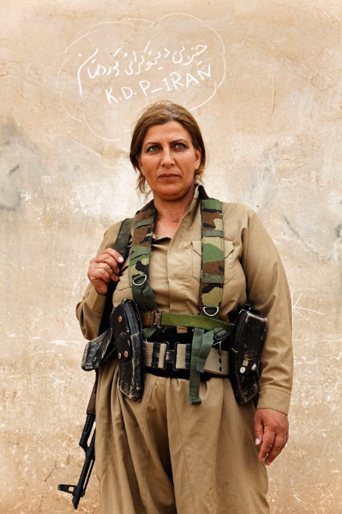 Kurdish peshmerga fighters: women on the frontline - in pictures. Kurdish peshmerga fighters have been in training for many years. Here, Maryam Ashrafi photographs women learning to use guns and training in various parts of Kurdistan. The Kurds of Syria and Iraq have become a major focal point in the war against Isis. | Portrait of a Kurdish woman Peshmerga inside the camp of Kurdistan Democratic Party of Iran.