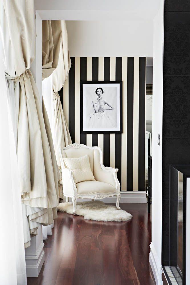 Intriguing graphic vignette, bold black and white stripes to highlight artwork. Adore Home magazine - Blog via @Alison Hobbs Hobbs Lambiase Home magazine