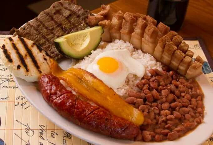 Bandeja Paisa – Colombia's national dish of rice, beans, chicharron, avocado, arepa, fried egg and other optional ingredients.