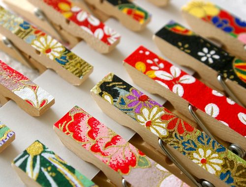 modge podge and paper on clothes pins - this would be great for making a gallery wall for displaying the kids' art in their room.