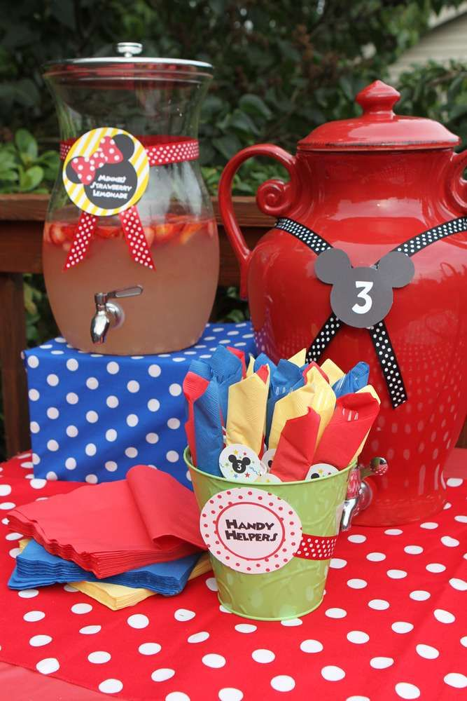"""Rosalee's cousin has two glass pitcher we can use for the strawberry le-minnie-aide. Get red ribbon and one of the 2"""" confetti minnie mouses to do decorations similar to this pic. Make a """"Strawberry le-minnie-aide"""" label."""
