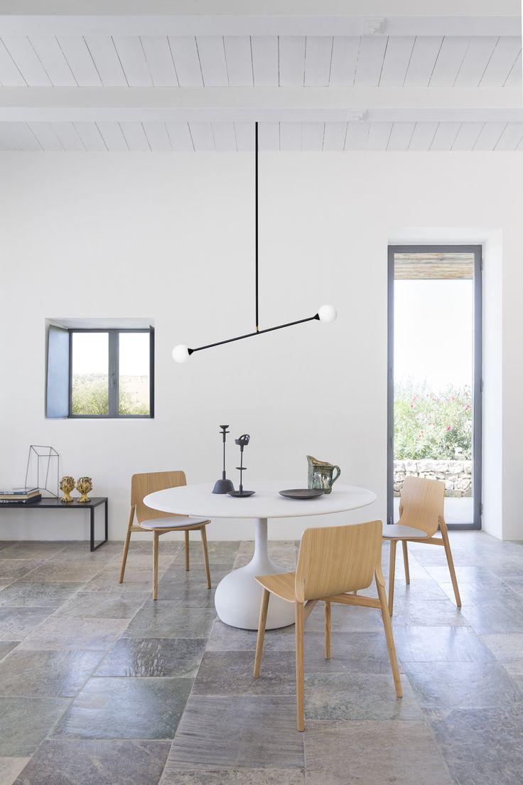 A living room with kayak wooden chair & saen concrete table  #alias #aliasdesign #aliasathome #aliasmood