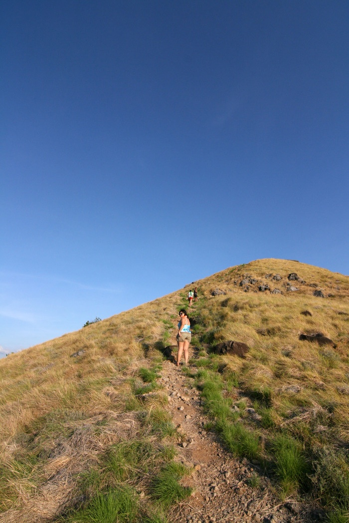 Climbing the hill in Seraya Kecil Island. Photo by Indra Febriansyah