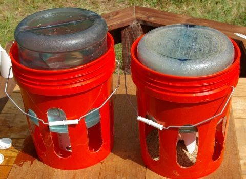 5 gallon water bottles, 5 gallon plastic bucket, a bit of drilling, a touch of PVC and voila! Chicken watering and feed buckets that mostly stay clean.