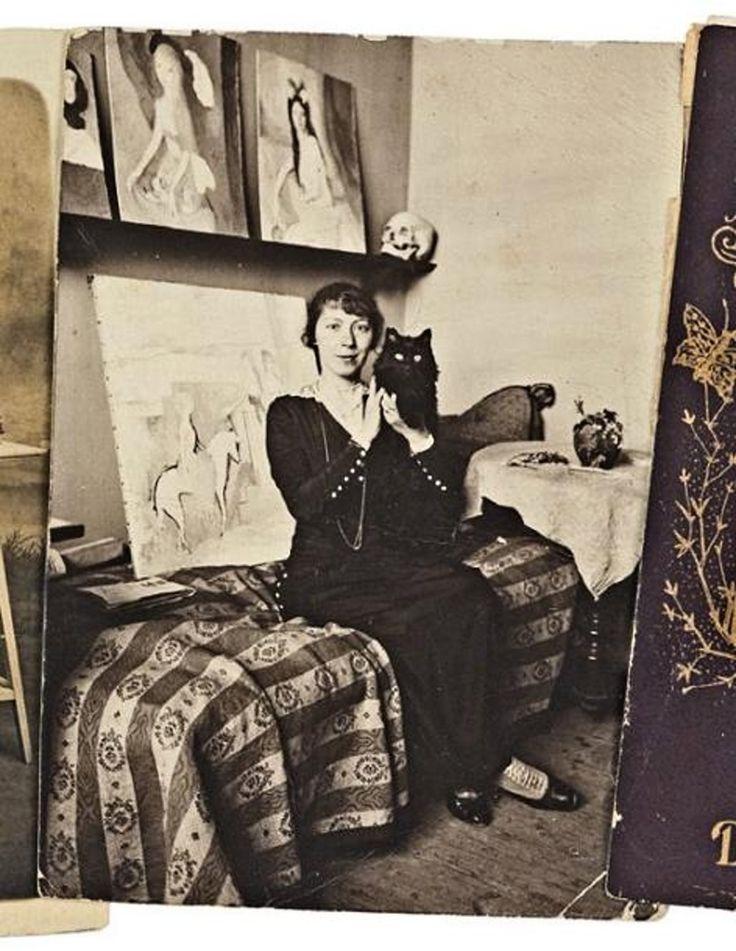 Marie Laurencin posing in her studio with a cute kitten, 1910's.