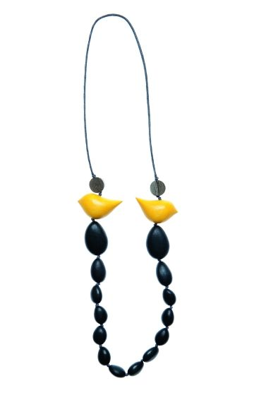 Handmade from plantation timber, the Birds & Pebbles Long Necklace is light to wear. Two sleek birds feature on each side of the wooden…