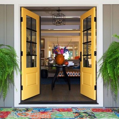 I like the yellow front doors, but I really love that mat with all its pattern & color!