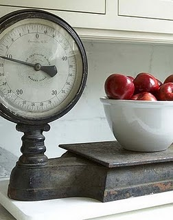 Add character to the kitchen with a few vintage items like this antique scale. For more ideas on using antiques in the kitchen click on the photo above.