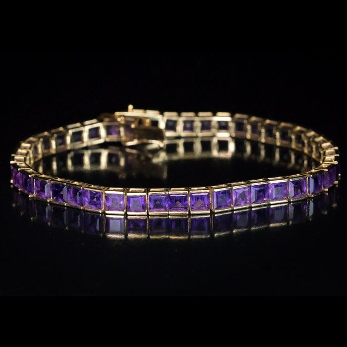 A Contemporary Amethyst and 14K Gold Line Bracelet set with well matched lavender purple step-cut square Amethysts. Length 18.8 cm (7 1/2 in.) Weight 14.13 g. •$2,200|| Romanov Russia - Buyers and sellers of fine antique jewelry and Imperial Russian antiques since 1998.