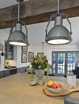 vintage marine lights hang above the kitchen's center island