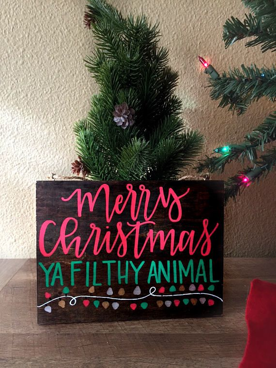 This beautiful wooden sign is handwritten and measures approximately 6 inches long and 8 inches wide. It is written in red and green and says Merry Christmas Ya Filthy Animal with vibrant Christmas Lights. This wood signs is calling all Christmas lovers! This is such a great