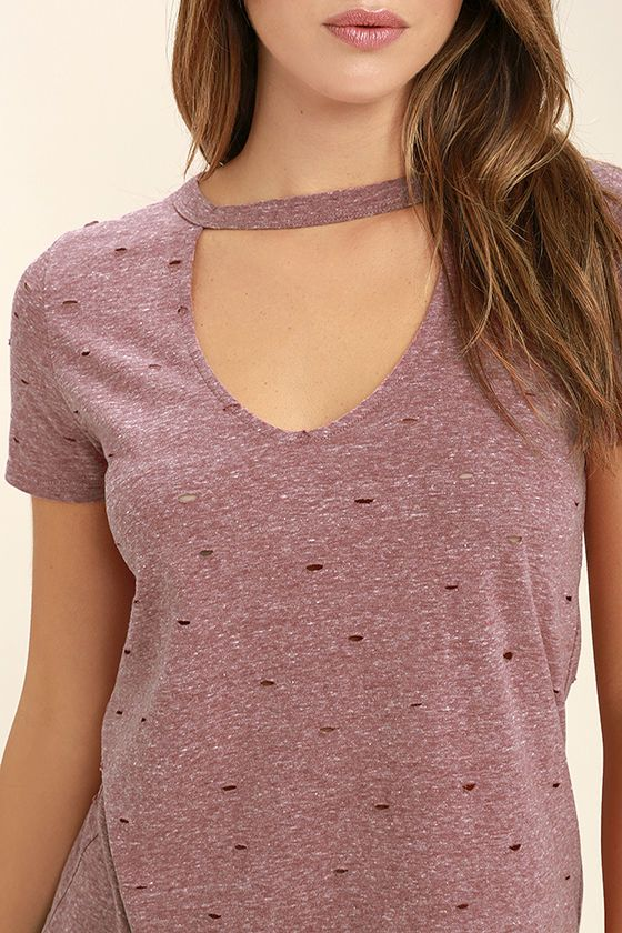 No one can do it quite like you in the Do You Washed Burgundy Distressed Tee! This comfy short sleeve tee has a washed and heathered look, distressing throughout, and a cutout neckline.