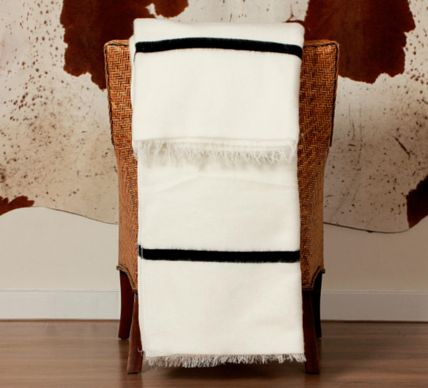 Xhosa Ingcawe Blanket. This dazzlingly bright white blanket with a striking black stripe (top and bottom) has fringed edges and is used to mark significant traditional occasions in the Xhosa culture.