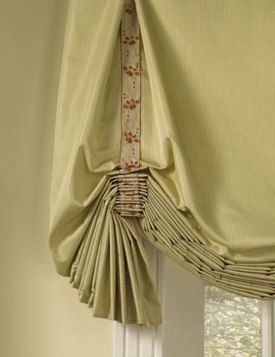 The folds in this Roman shade are highlighted by applying a banding vertically.