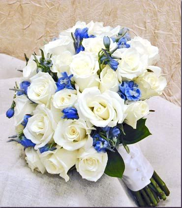 White Rose & Delft Blue Delphinium - Option 6 Part of Bridal/Gazebo to incorporate Stargazer Lily. Bridesmaid, Groom/Groomsmen & Aisle arrangements remain Blue and White