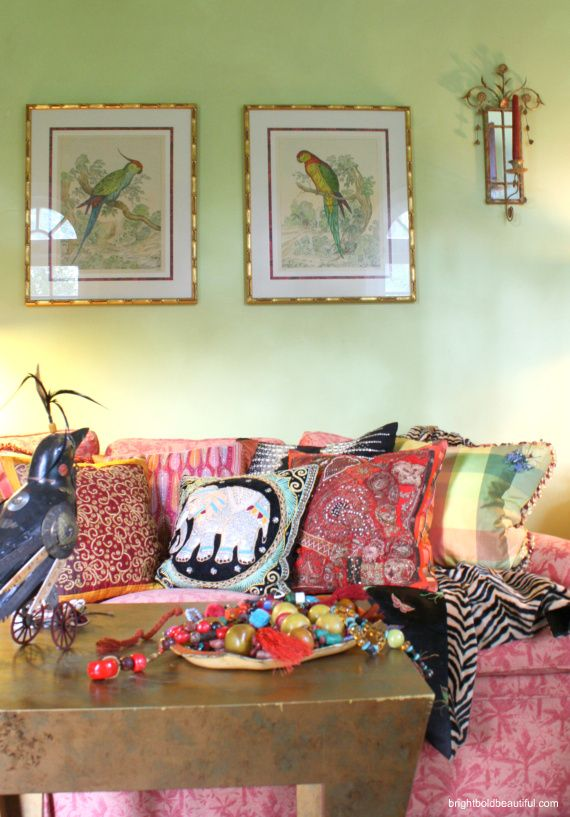 ethnic and bohemian living room (I love the parrot pictures!)