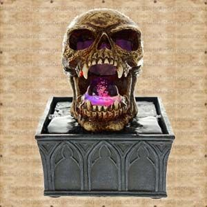 A haunting skull sitting on a tomb. This gothic centre piece will be the talking point of any room, his mouth and eyes light up with changing colour and has water turning through his mouth topped by a glass ball. The skull measures approx 11cms tall and takes 3 AA batteries. The Jaws Water Feature Skull brought to the Skulls and Dragons skull range by Nemesis Now.    Height : 18 cm    Width : 13 cm    Length : 13 cm    Weight : 1250.00g    Made from resin £21.99