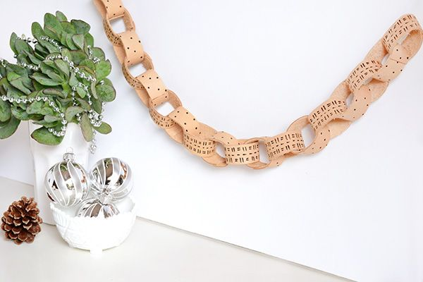 http://makeandtell.com/make-it-leather-chain-garland-for-merry-mag/