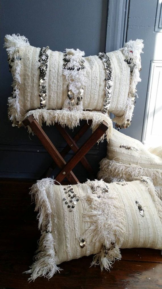 Handmade pillow constructed from vintage Moroccan wedding blanket with down fill. Composition: wool woven vintage handira, cotton fringe, metal