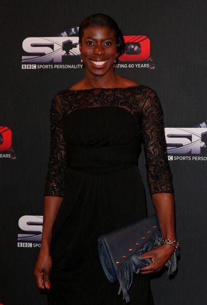 Christine Ohuruogu Athlete at Spoty awards using the navy Blue Raglan Fringe Clutch Leather bag by www.driftwoodbags.com