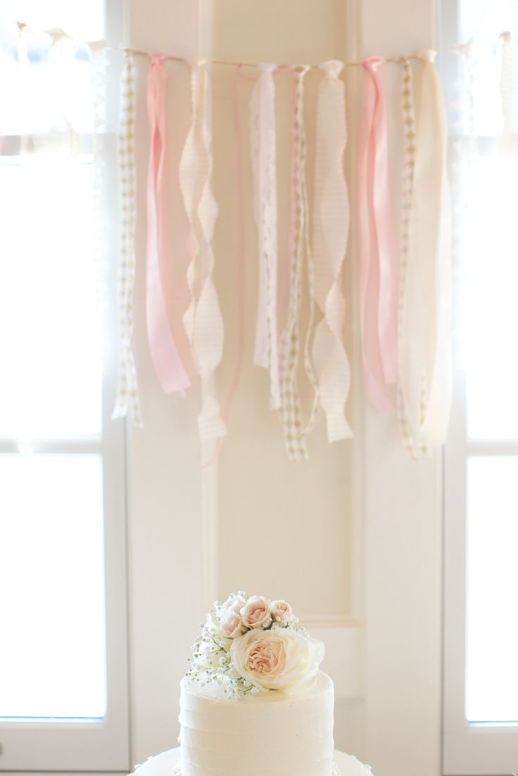 ribbon bunting decorating the cake table Photography: Taylor Rae Photography - taylorraephotography.com  Read More: http://www.stylemepretty.com/southeast-weddings/2014/04/24/romantic-downtown-charleston-wedding/