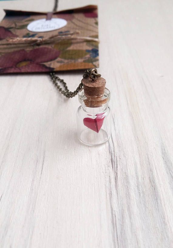 This beautiful globe bottle pendant has a mini paper heart inside. Bottle Size: about 15mm x 22mm. This would make such a lovely gift for someone who really appreciate the small, beautiful things in life. All the products are shipped well packaged, in a custom packet with a little gift