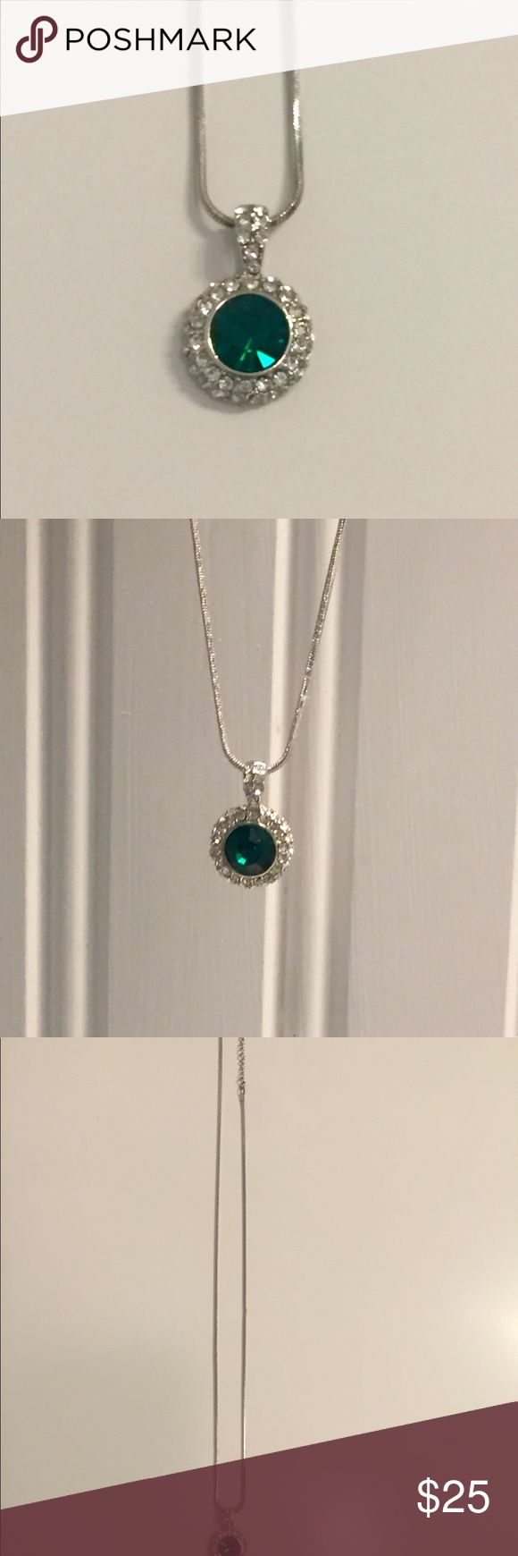 Stunning Emerald Necklace Silver, 18 inch necklace featuring a vibrant emerald stone surrounded by rhinestones. please note the emerald and silver are not real, which is reflected in the price, along with the rhinestones (not diamonds). Necklace has never been worn. reasonable offers welcome. Jewelry Necklaces
