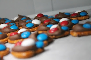 4th of July - Pretzels, hershey's kisses, and m! Perfect mix of salty and sweet!