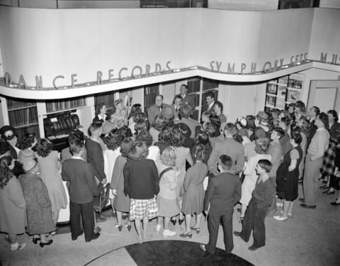 CVA 1184-2073 - crowd gathered inside a music store to see John Charles Thomas