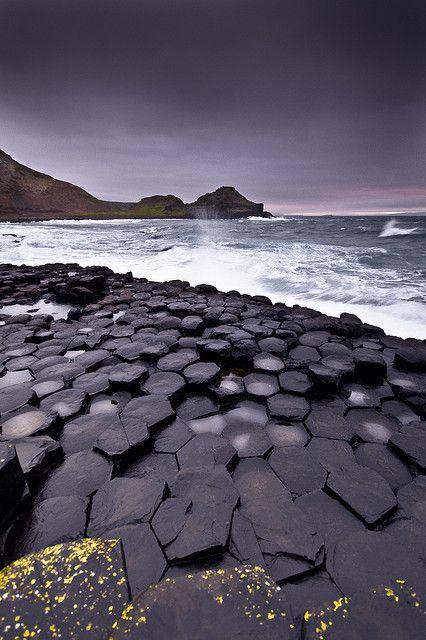 Giant's causeway - A magnificent volcanic basalt hexagonal rock formation in Ireland. #travel