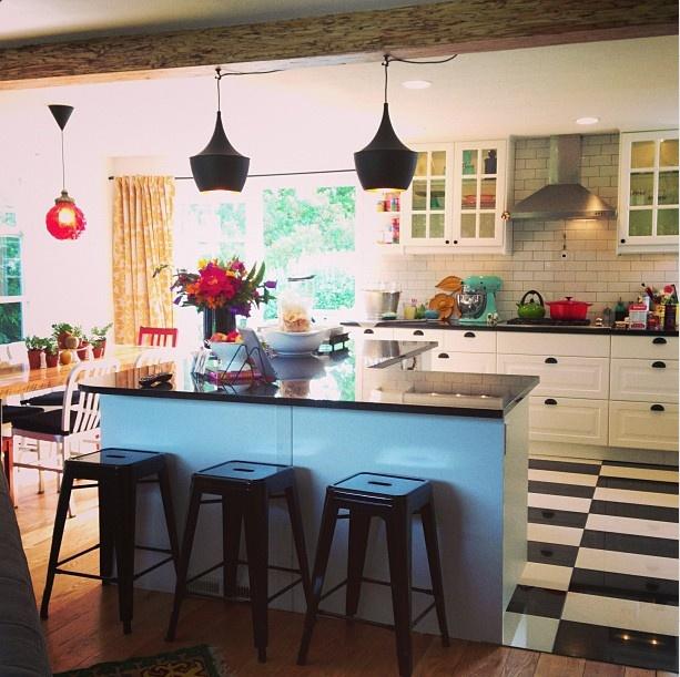 Love the light in our remodeled kitchen. Black and white tile floors, subway tile, black granite, pendant lights.