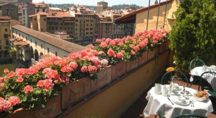 Hotel Hermitage Florence Located next to the Ponte Vecchio, Hotel Hermitage offers panoramic views of Florence's historic centre from its rooftop terrace. It features air-conditioned traditional rooms with Sky TV and private bathroom.