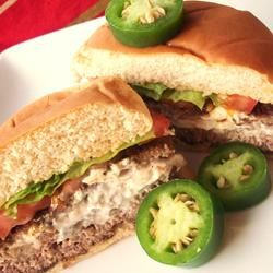 Cream Cheese Jalapeno Hamburgers--- I mixed the meat with the jalapenos, cayenne, cajun seasoning, pepper and garlic sauce. Then put the cream cheese- jalapeno mix into the burgars like it says... I think BACON would be good in the cream cheese, too!!